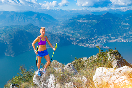 Trail running in the mountains athlete blonde woman