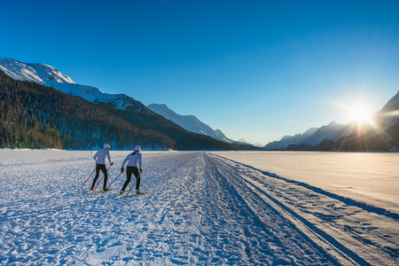 Couple man and woman cross-country skiers ago training skating technique Stock Photo