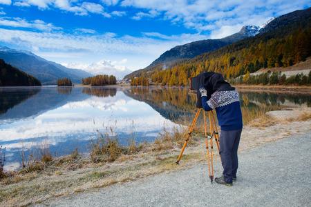 landscape format: Landscape photographer with medium format vintage film plate camera