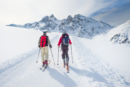 roped: Group of climbers roped to the summit in the winter Stock Photo