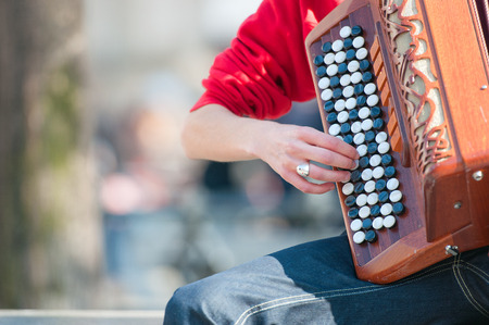 Accordion buttons in a girl played street Stock Photo