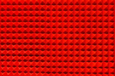 vibrations: Red pyramid sound-absorbing panel of the recording and radio studio
