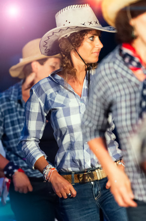 Country dance school girlswith typical clothes and hat