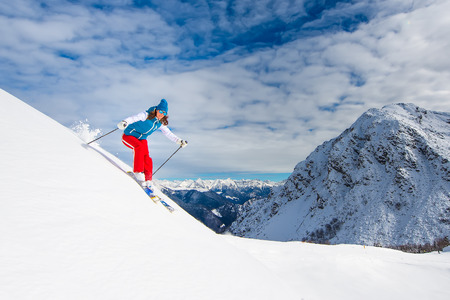 Cheerful girl in off-piste skiing Stock Photo