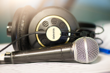 Microphone and headphones to record singer