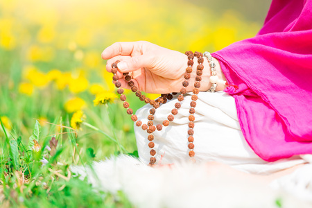 Use of Mala with mantras during a yoga practice flourished in nature