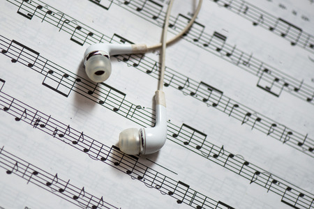 musical score: Musical score with white headphones