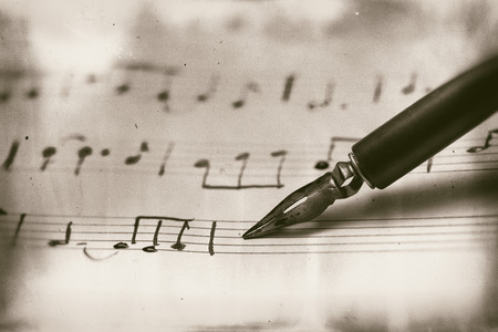 musical score: Old musical score with fountain pen Ruined vintage style photograph Stock Photo