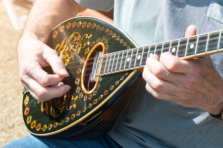 Bouzouki outdoor man performance player