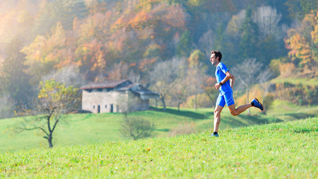 Run into nature in the mountains an athlete man.
