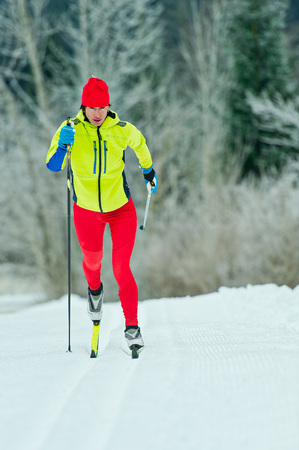 Cross-country skiing classic technique  practiced by woman.