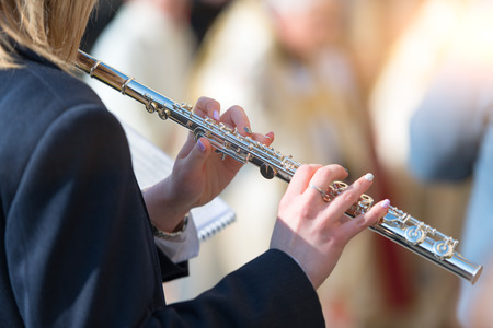 DOSSENA, ITALY - March 23, 2018: During the procession Madonna di Dossena in the province of Bergamo Italy. Transverse flute plays in the band 新聞圖片