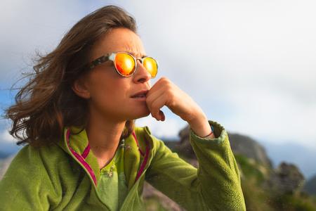 Portrait of caucasian girl resting during an alpine trekking. Imagens