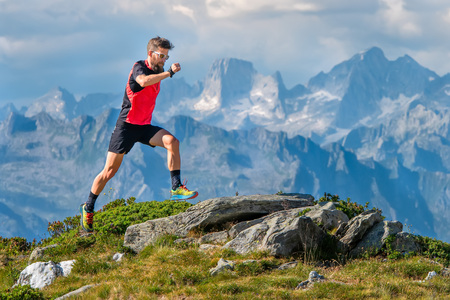 A skyrunner athlete man trains in the high mountains. 写真素材 - 105041639