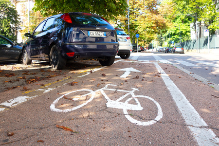 Milan, Italy - September 7 2018: Cycle area with cars in parking that disturb the passage
