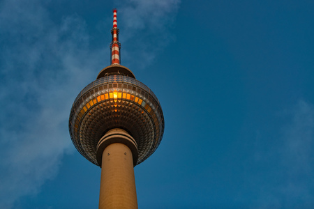 Television tower in Alexanderplatz in Berlin, The sun of the sunset is mirrored.