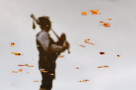 Reflected in water with leaves of a bagpiper.