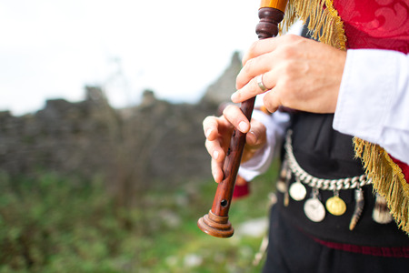 Bagpipe player detail. With traditional dress. Stock fotó
