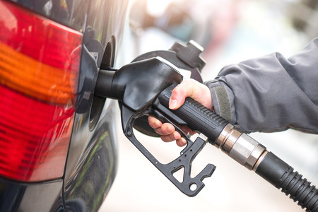 Gasoline pump during supply to a car.