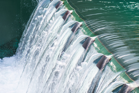 Detail of a dam with flowing water.