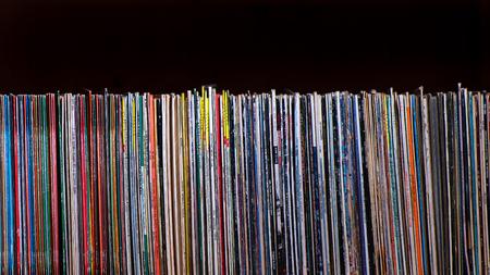 SAN PELLEGRINO TERME, ITALY - DECEMBER - 20 - 2018: Many 33 rpm album vinyl records on a black background Sajtókép