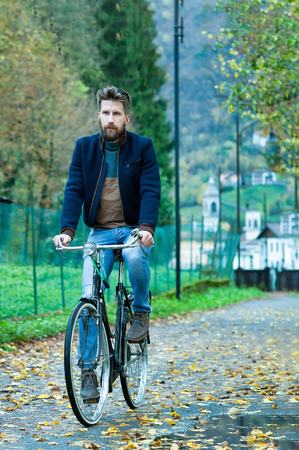 Young man with bicycle boat on bike path. Stock Photo