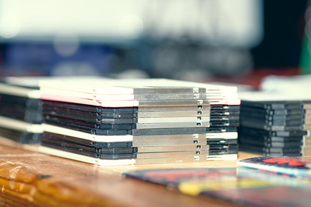 Old stacked floppy disks on the table. Stock Photo