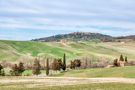 Typical Tuscany landscape in Val dOrcia. In the background the medieval village of Pienza