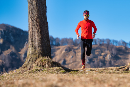 Young runner trains on hilly trails