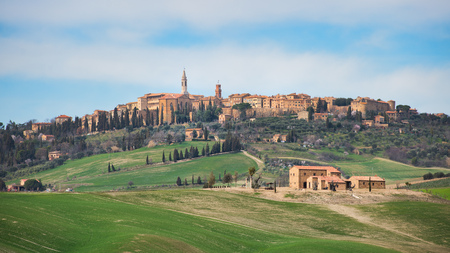 Hills of meadows below the medieval village of Pienza in Tuscany