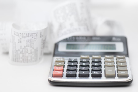 Calculator with many receipts for calculating family budgets Stock Photo