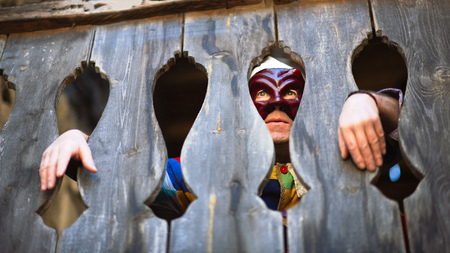 The mask of Arlecchino. Look between the wooden terrace