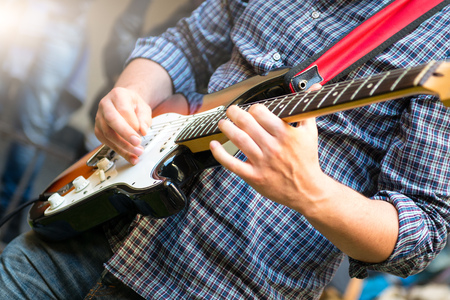 Electric guitarist of a young group during a show