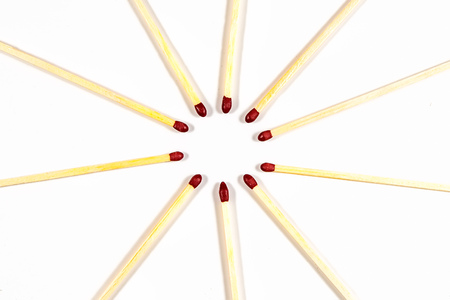 Some matches in a circle on a white background