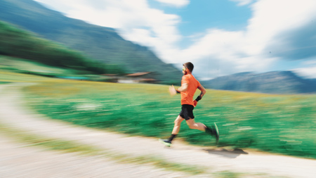 Runner pass in the mountains in spring with blur Standard-Bild