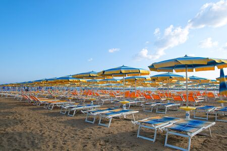 Umbrellas and sun loungers on the beach in the Adriatic. Romagna Riviera in Italy