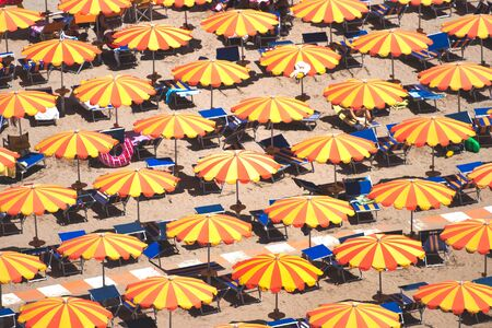Detail of umbrellas on the beach on the Romagna coast in Italy Stock Photo