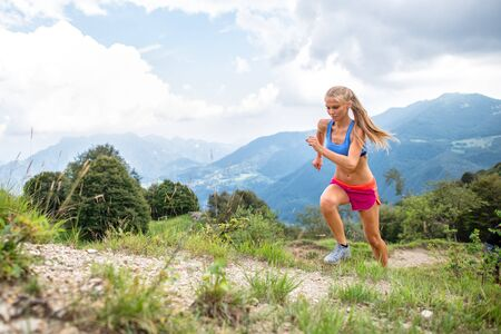 Girl skyrunner in action during uphill mountain race