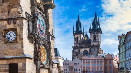 Astronomical clock in the old square of Prague with the church of the Virgin Mary of Tyn. Stock fotó