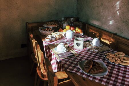Rural farmhouse with breakfast table Stock Photo