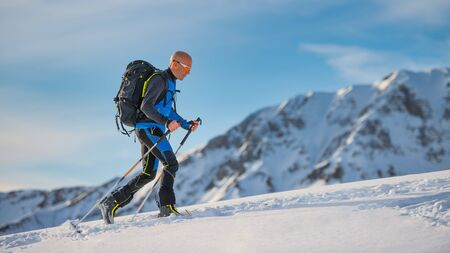 Uphill with skis and seal skins on the Alps