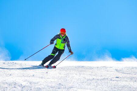A girl skiing on the ski slope