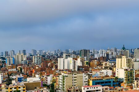 Skyscrapers and many houses in the city of Lima in Peru Stock Photo