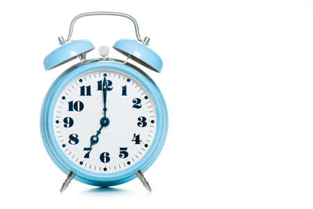 Classic table alarm clock in green color on a white background