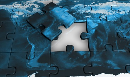 Incomplete jigsaw with a earth map photo