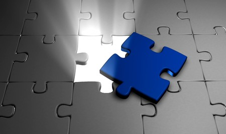 missing link: 3d image of a jigsaw with a blue piece and a glowing light Stock Photo