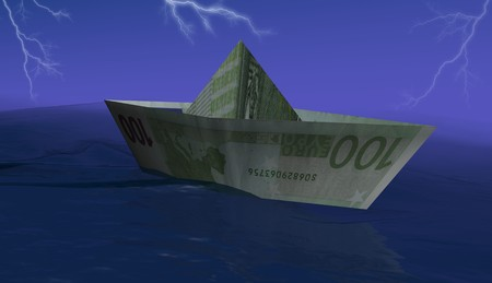 hundred euro paper boat in the storm photo