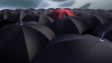 red umbrella: red umbrella between a lot of  black umbrellas Stock Photo