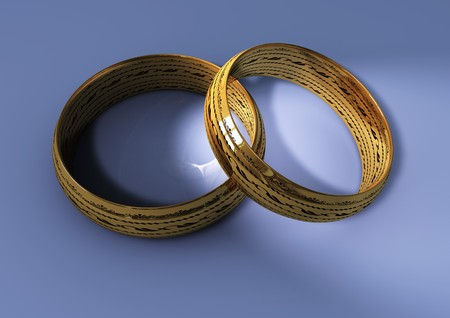 macro of two rings with caustics on blue floor photo