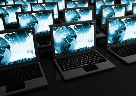 scloseup of Laptops on black reflective surface photo